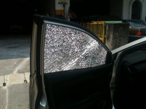 Auto winding glass window shattered by unidentified object