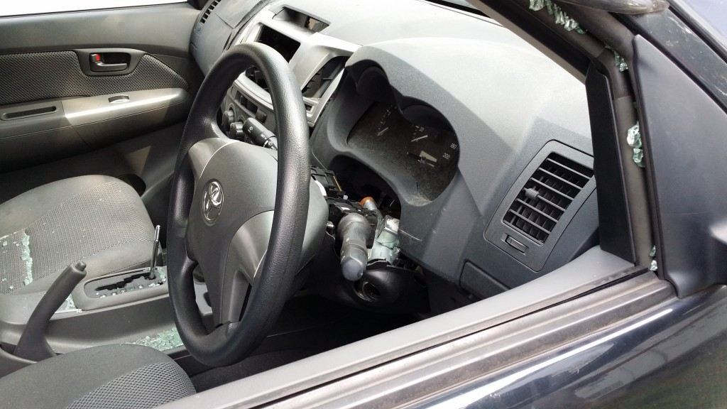 Driver's glass window was broken to steal car