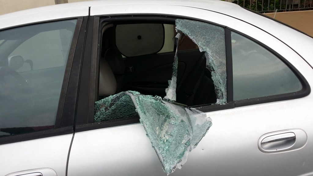 Car glass window was broken to steal some items inside the car cabin